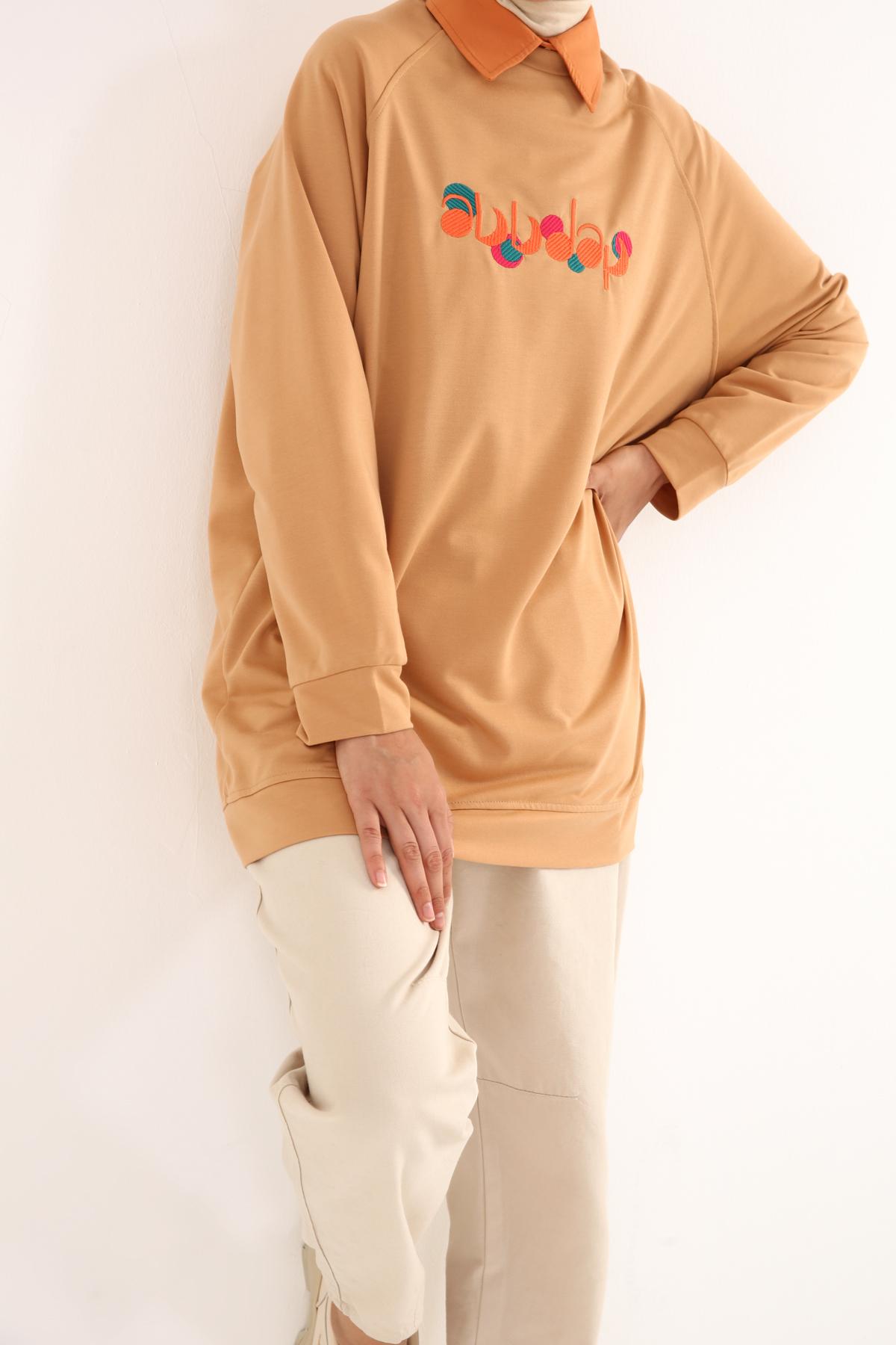 Raglan Sleeve Embroidered Sweatshirt Tunic