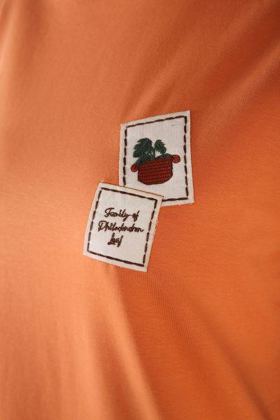 Kolları Şeritli Çiçek Amblemli Tunik
